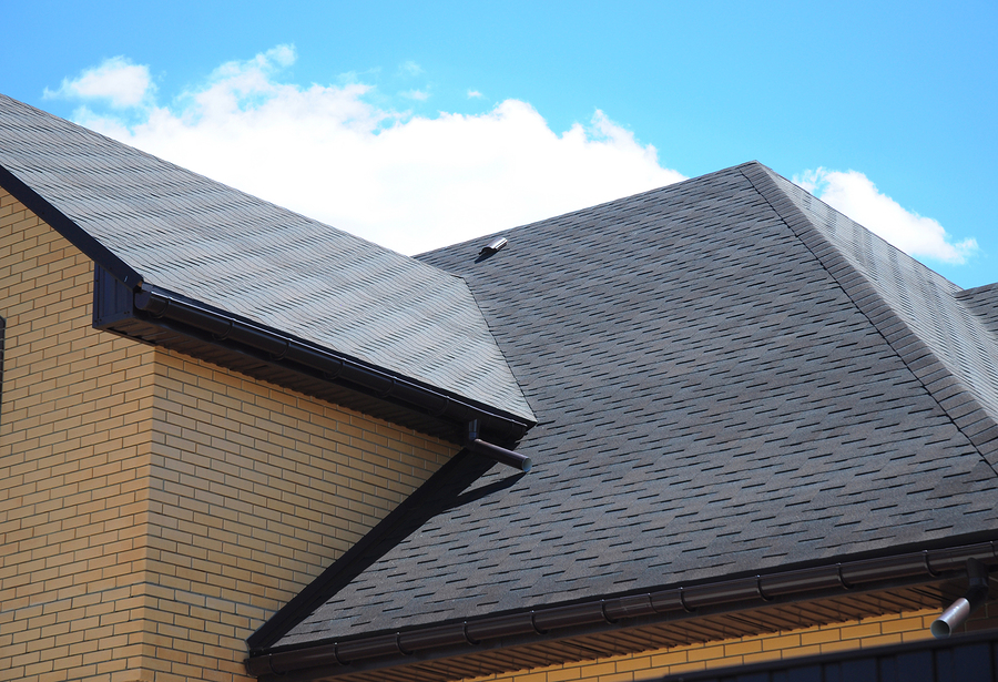 Tight Budget? Layering Asphalt Shingles Over Existing Ones